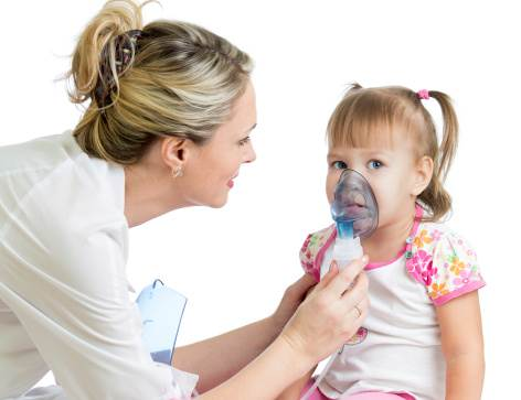 Doctor holding inhaler mask for kid girl breathing